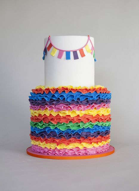 Happy Birthday Amigo!    A birthday cake created for a Mexican themed party.   Ruffles, ruffles and more ruffles... bright and cheery!  Carrot cake filled with white chocolate ganache.  Cinco de mayo!