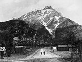 Charles Leroy and first milk cow on Banff Avenue, 1888, photograph by A. B. Thom, (V180/NA66–1796, Ron Duke fonds), Whyte Museum of the Cana...