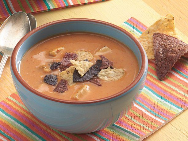 Just made this with a leftover rotisserie chicken. SO EASY. It's not spicy, though, but hubs doesn't like spice so it turned out perfect. Not as dark as the picture, and if you like spicy, maybe add a package of taco seasoning. Yum! >>> Cheesy Chicken Enchilada Soup