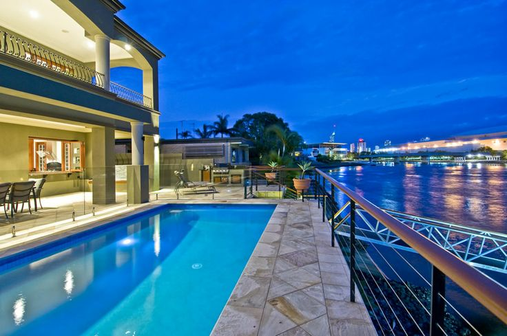 Outside Lakeland Keys holiday home (Gold Coast) offers alfresco dining, a gorgeous swimming pool, BBQ, jetty & pontoon, kayaks & fishing rods PLUS a spectacular view.