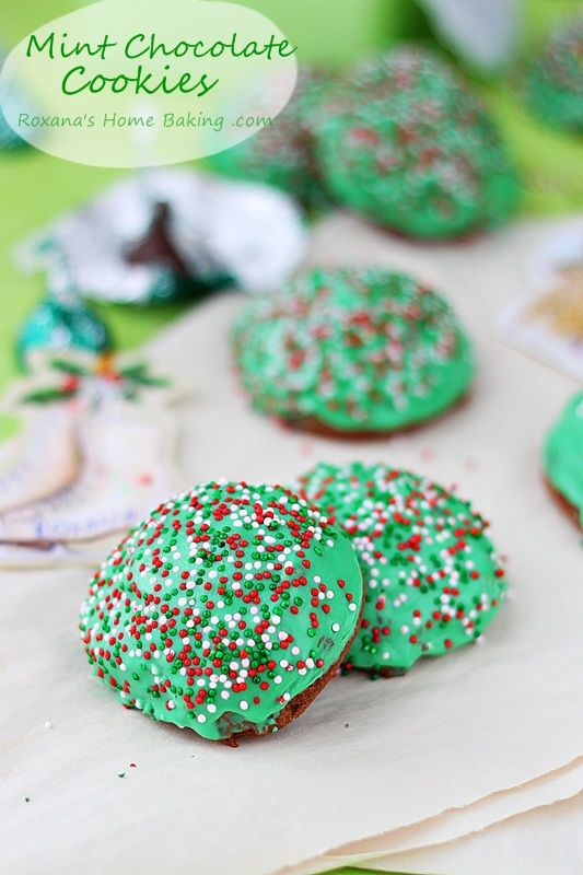 Soft and chocolate-y muffin top cookies with chopped mint Hershey's kisses and dipped in mint chocolate ganache for a Christmas-y look from Roxanashomebaking.com