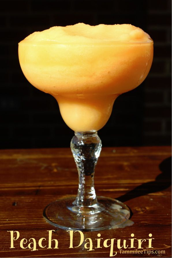 Fresh Peach Daiquiri Recipe is the perfect frozen cocktail! So easy to make and tastes amazing!  You can also easily adapt this to be a non alcoholic recipe!