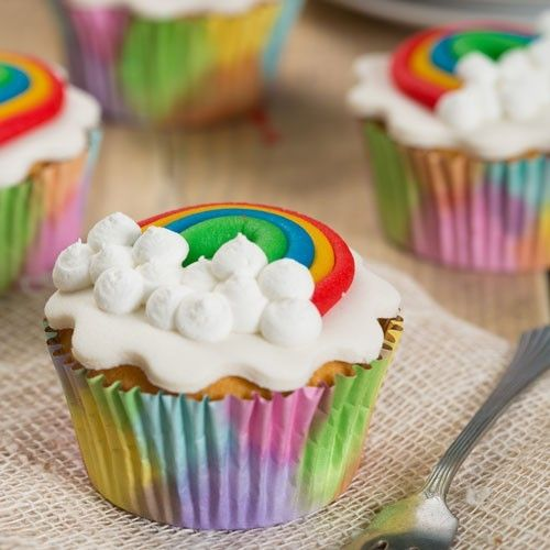 Follow the rainbow with cupcakes! These cupcakes are easily made with the FunCakes mix for cupcakes. Then roll out various colors of fondant and create the rainbow. At last, make some royal icing to create the clouds on the cupcakes. These are the perfect cupcakes for children.  Rainbow cupcakes - Cupcakes - Recipes  | Deleukstetaartenshop.com
