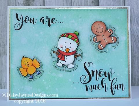 Who says just kids lay down to create snow angels in the snow? Santa, a reindeer, a snowman, a bird and a gingerbread man are having just as much fun! Even though I do wonder if the gingerbread man mi
