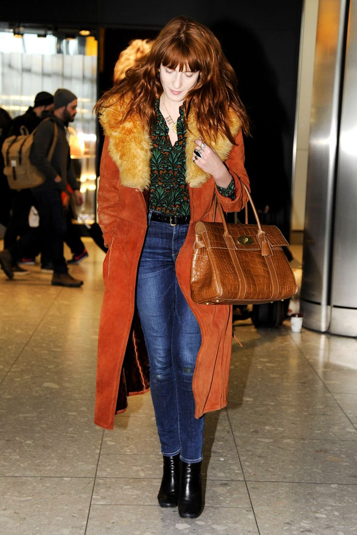 15 Celebs Who Rule At Travel Style #refinery29  http://www.refinery29.com/58879#slide4  A statement coat is perfect for travel. It allows you to wear whatever you like underneath and lets your topper do all the sartorial talking. Florence Welch's mega-collared number is a brilliant example. And, the fact that it matches her locks just so? That's the cherry on top.