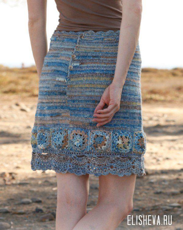 Меланжевая юбка «Голубая мечта» с ажурными узорами от Drops Design, вязаная крючком
