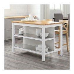 Free-standing kitchen island; easy to place where you want it in the kitchen. Two fixed shelves in stainless steel, a hygienic, strong and durable material that's easy to keep clean. Countertop with a top layer of solid wood, a hardwearing natural material that can be sanded and surface treated when required. Good environmental choice, because the method of using a top layer of solid wood on particleboard is resource-efficient.