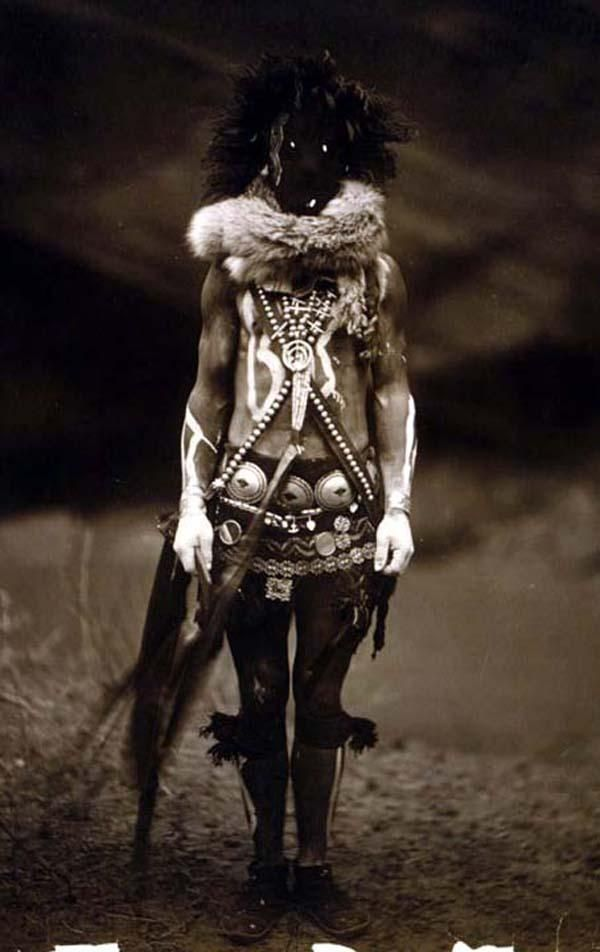 13 different pictures in this link. They're all a bit terrifying!! But this one: This is a 1904 portrait of a Navajo dressed as the deity Nayenezgani, the God of sadness and nightmare fuel, we're assuming. Presumably this was part of a revenge plot -- white people took aboriginal land, so the natives took away their ability to sleep. In some photos, it looks like a person is having his face swallowed by a randomly appearing black hole.
