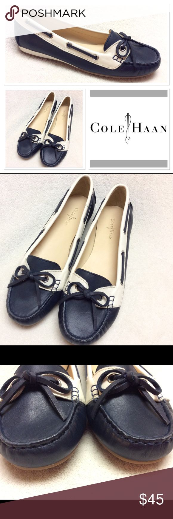 8.5B COLE HAAN navy & white boat shoes Never worn leather loafers/boat shoes by Cole Haan. Bow on toe, navy with white trim. Have been stored out of the box. Excellent condition! Cole Haan Shoes Flats & Loafers