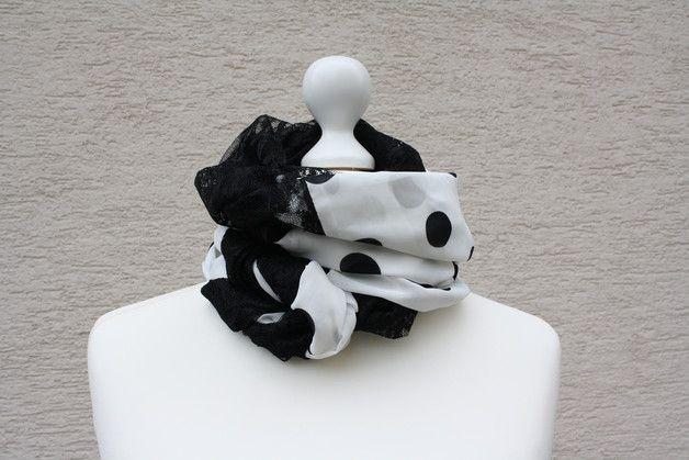 Hier das nächste Exemplar der Kollektion Loopmania: dieses Mal ein besonders edles und elegantes Exemplar aus hochwertigem Georgette in creme-weiß mit schwarzen Tupfen und Spitzenstoff in schwarz....