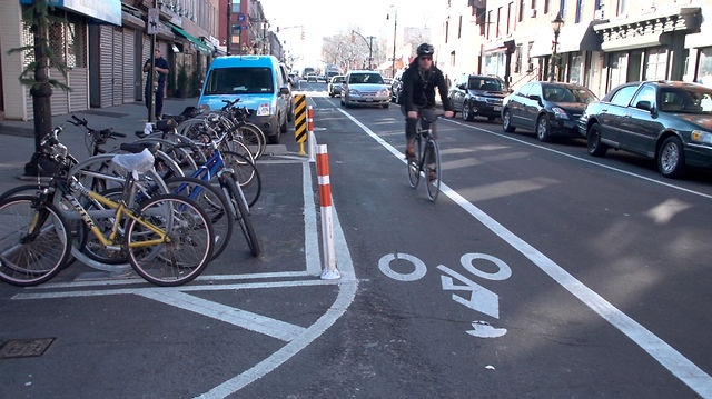Bike Corrals: Trading a single curbside parking spot into on-street bike parking. It's a winner for all - fewer bikes blocking the sidewalk, more bike parking and (most importantly) improved sightlines resulting in FEWER CAR ACCIDENTS.