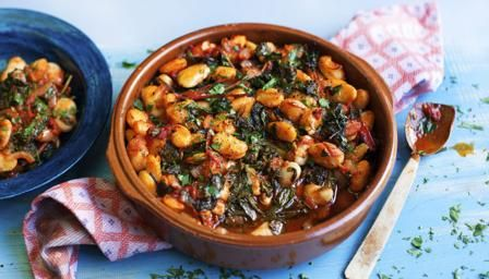 Ingredients 500g/1lb 2oz dried gigantes beans or butter beans, soaked overnight 1 onion, chopped 2 garlic cloves, chopped 6 tbsp olive oil ½ tsp sweet paprika 1 tbsp tomato purée 1 x 400g tin chopped tomatoes 1 tsp salt freshly ground black pepper, to taste 350g/12oz chard or spinach, washed small handful fresh parsley, chopped small handful fresh mint, chopped
