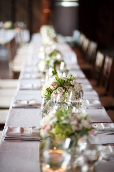 Lovely elegant table setting.  Love the flowers, glasses and simple cutlery