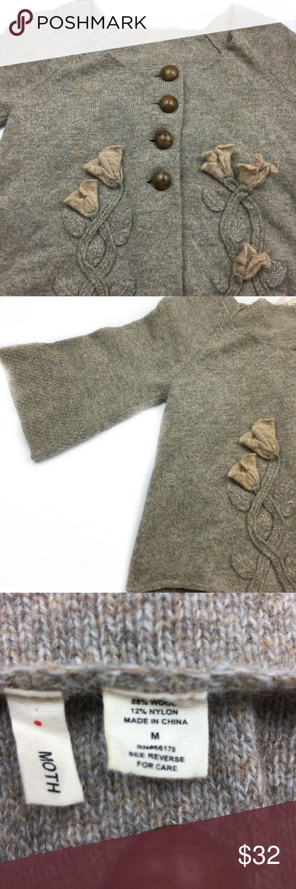 Moth women's 80% wool sweater  with knitted flower Moth women's 80% wool sweater  with knitted flowers size M. Lovely used.     We will ship all orders within 1 business days of payment (does not include Sunday or US Holidays).  If you are unsatisfied with your order, please contact us via email. Moth Sweaters