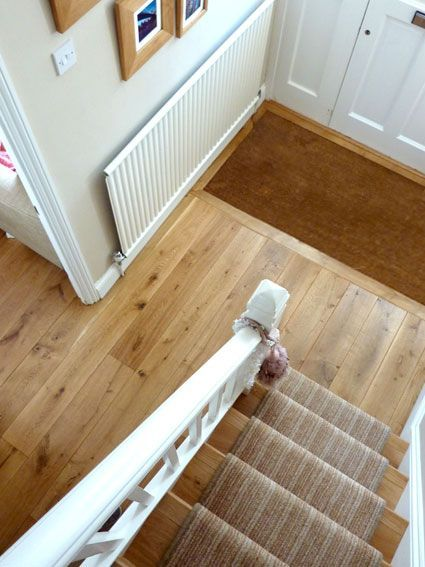 Rustic French oak flooring in the Hall. Stairs are cladded with the same rustic French oak. There is a sunken matt with coir matting by the Entrance door.