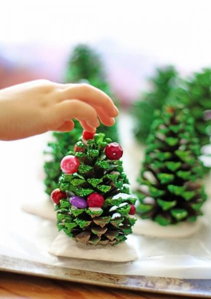 Let the kids help decorate a pinecone Christmas tree.