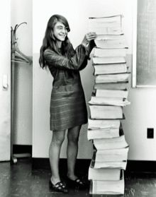 Margaret Hamilton worked on the Apollo Guidance Computer which controlled the Apollo mission. She's standing next to the source code which she wrote by hand. Amazing woman.