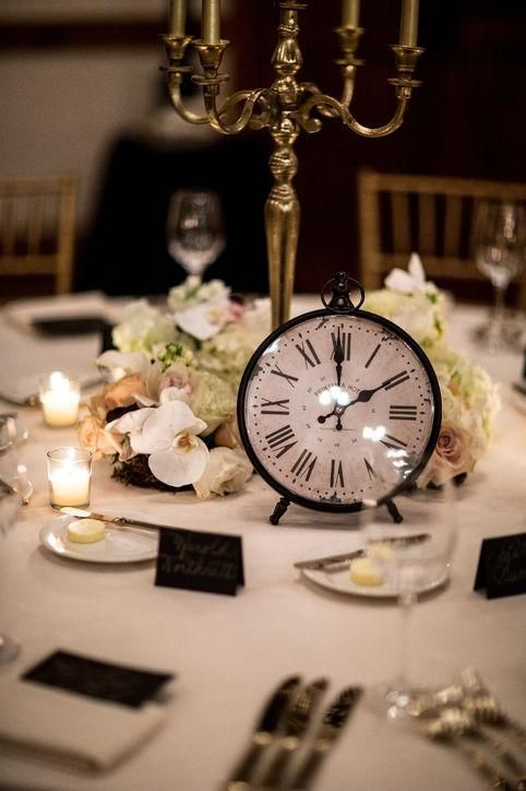 Real wedding inspiration from this New Year's Eve wedding. From classic clocks table decor to the glittering tablescapes, see all the beautiful pictures