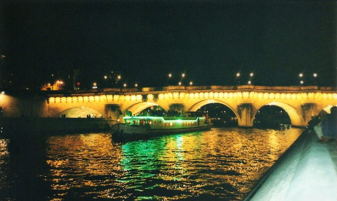 A beautiful night to take a boat cruise around The Seine in Paris, France.