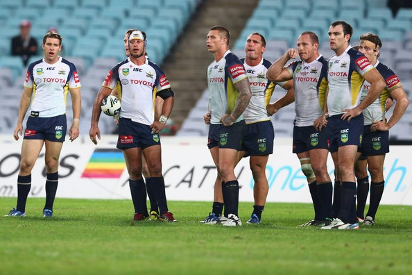 The Cowboys look dejected after a Rabbitohs try during the round nine NRL match between the South Sydney Rabbitohs and the North Queensland Cowboys at ANZ Stadium on May 10, 2013 in Sydney, Australia.