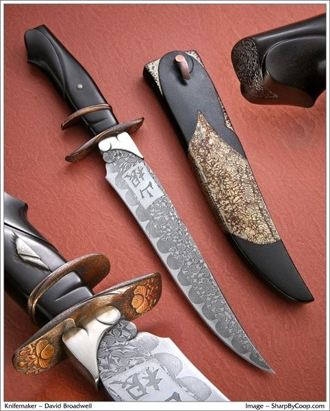 The owner of this knife requested one of Broadwell's sub hilts with Persian and Japanese influences. His name is Yamane and he wanted his name in the steel in kanji. The Persian part is in the upswept blade shape. Broadwell collaborated with Mastersmith Tom Ferry. Ferry created the composite blade with the name Yamane in kanji in the steel, not etched on top of it. The owner's family mon, or crest, is carved into the face of the guard. Symbols associated with the family include Mt. Fuji, and BroPretty Knives, Mosaics Damascus, David Broadwel, Custom Knives, Sterling Silver, Weapons, Blade, Japanese Influence, Knife Maker