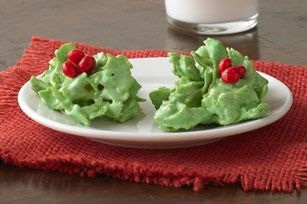 No-Bake Holly Cookies recipe  1/3 c butter, 30 marshmallows, 1 1/2 t green food coloring, 3 c cornflakes, 2 t cinnamon red hot candies.  Melt butter & marshmallows, add food coloring, mix in cornflakes,  Drop by T.  Press candies into mound.