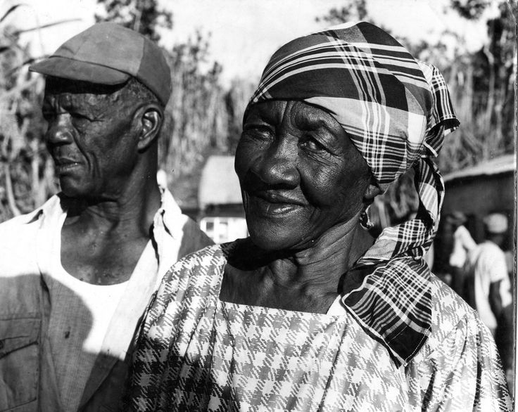 """""""Maroons from Accompong, St. Elizabeth, Jamaica,"""" from the National Library of Jamaica Photograph Collection, ca. 1968.        Accompong is an historical Maroon village in the parish of St. Elizabeth, Jamaica. It is named after the Maroon leader, Accompong, brother of Quao, Cudjoe (or Kojo), Cuffy and Nanny, also Maroon leaders from the Ashanti family of Ghana."""