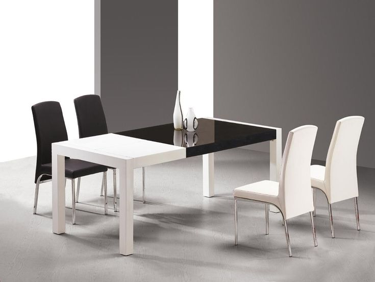 Two Toned Black And White Dining Table With White And Black Chairs