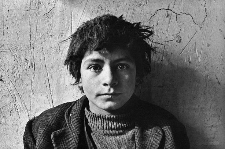 Young seasonal laborer in Iran, in the seventies. Two eyes, each with its own signification... Left, more in the light, as a normal figure and the other, stepping into the shadow, more mysterious. A 10 years old kid whose perspective is hard working, and more dramatically war, famine, disease, religious insanity. Photographer : Kaveh Golestan.