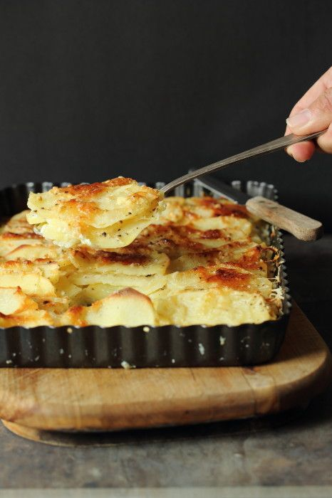 These Garlic Parmesan Potatoes Au Gratin are the creamiest and most delicious you'll ever try! Thin sliced and full of cheese. The perfect side dish!