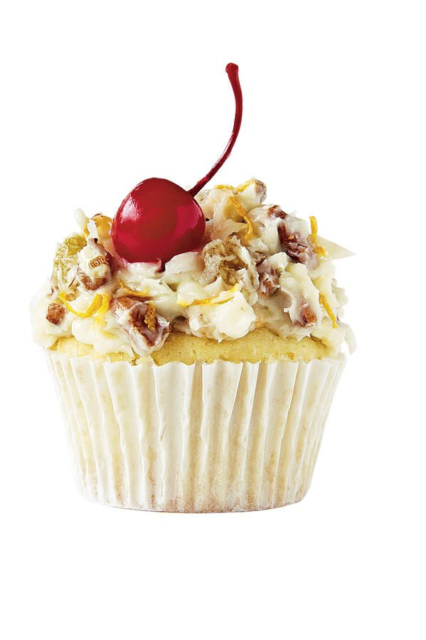 Alabama: The Alabama Lane Cake - College Football Cupcakes - Southernliving. Inspiration: The iconic southern cake  Stir 3/4 cup chopped toasted pecans, 3/4 cup sweerened flaked coconut, 1/2 cup chopped golden raisins, and 1 tsp. orange zest into frosting. Garnish with maraschino cherries with stems.