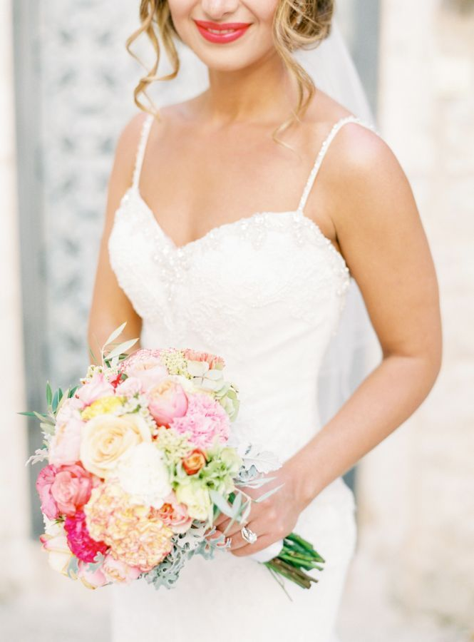 pink, peach, and yellow hued wedding bouquet