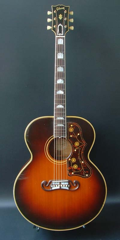 "Gibson SJ-200 (1949) : I could marry this guitar!! Love it!!!  ""63 year-old guitar looks so young! GIbson entered into production of this top-of-the-line flat  top guitar model in 1938 in the name of ""Super Jumbo"", changing it to ""Super Jumbo 200 (SJ-200) in the next year. They changed the name again to ""J-200"" in 1955."""