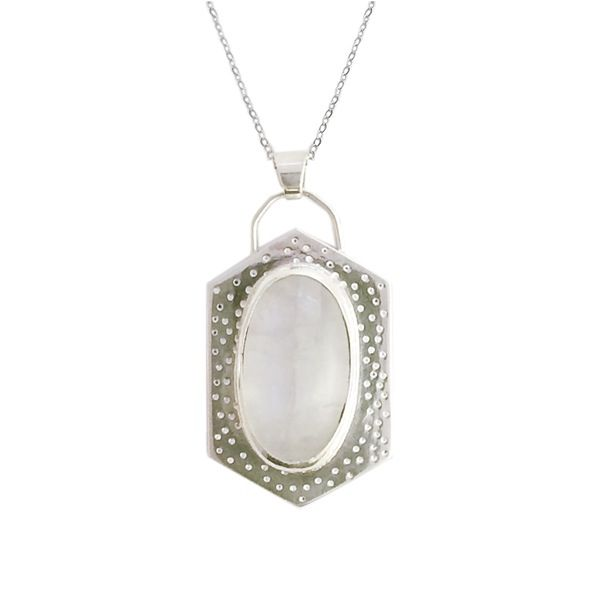 """This sterling silver necklace features a long hexagon shape, a stippled pattern, and a bright oval moonstone set in fine silver. Hangs from a 30"""" sterling silver chain."""