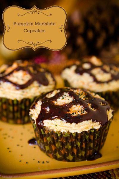 Pumpkin Mudslide Cupcakes... Pumpkin AND alcohol?! flour, pumpkin pie spice, instant coffee, baking soda, salt, sugar, pumpkin puree, eggs, vegetable oil, kahlua, bailey's irish cream, butter, powdered sugar, vanilla extract, chocolate syrup