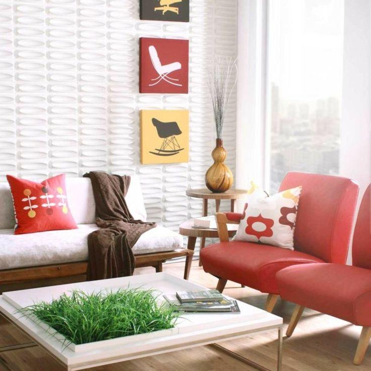Panneau mural 3 D pour le salon avec un canapé rembourré et chaises corail