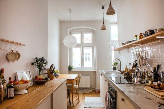 Kassandra chose her Berlin apartment's permanent materials —flooring, bathroom subway tiles, custom kitchen countertops, cabinetry and more.