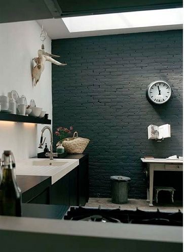Black brick wall in kitchen.