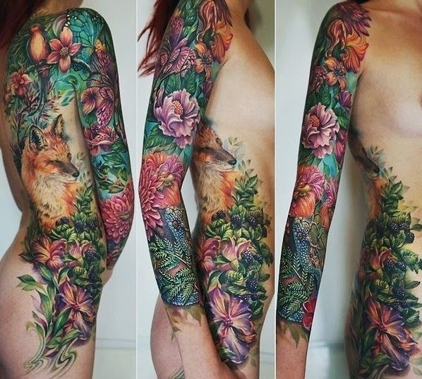 elaborate nature tattoo with flowers, leaves and a fox                                                                                                                                                     More