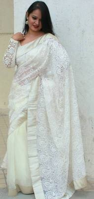 Gorgeous off white saree in pure chiffon and hand embroidery with silk threads on lace with thick silver pure brocade . This piece comes with an off white embroidered blouse piece