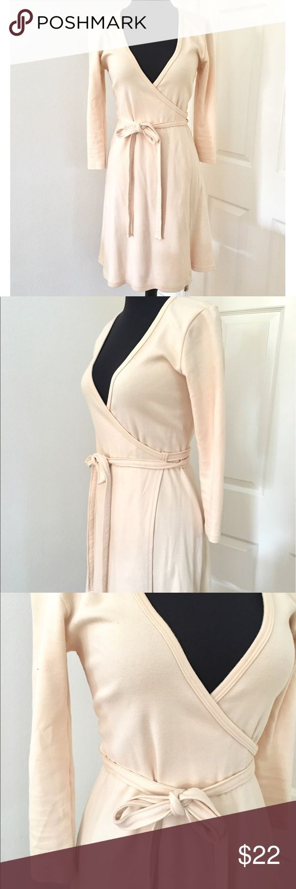 """Rare American Apparel Wrap Dress in Small American apparel dress - rare find. Wrap dress. Long sleeves. Thick, comfortable, interlock 100% cotton in versatile off white shade. Great with boots for a more casual look of dress it up with heels. Size S. 36"""" long. American Apparel Dresses Long Sleeve"""
