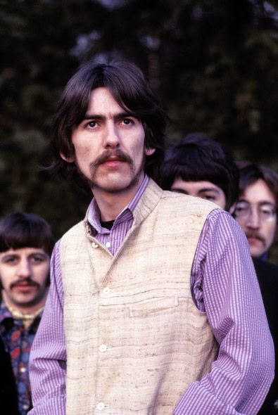 George Harrison poses with the Beatles during a photo shoot at Ringo's house for Life Magazine in 1967.