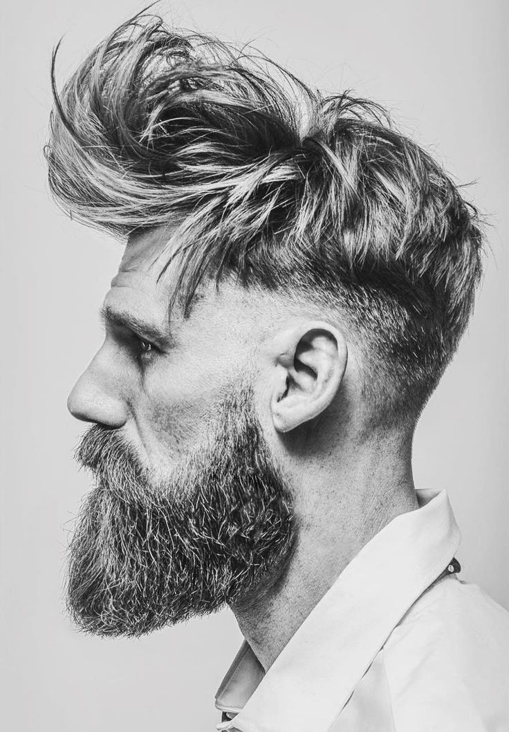 Long messy textures with low bald fade and full beard. Amazing haircut by barber Matty Conrad. #haircuts #menshaircuts