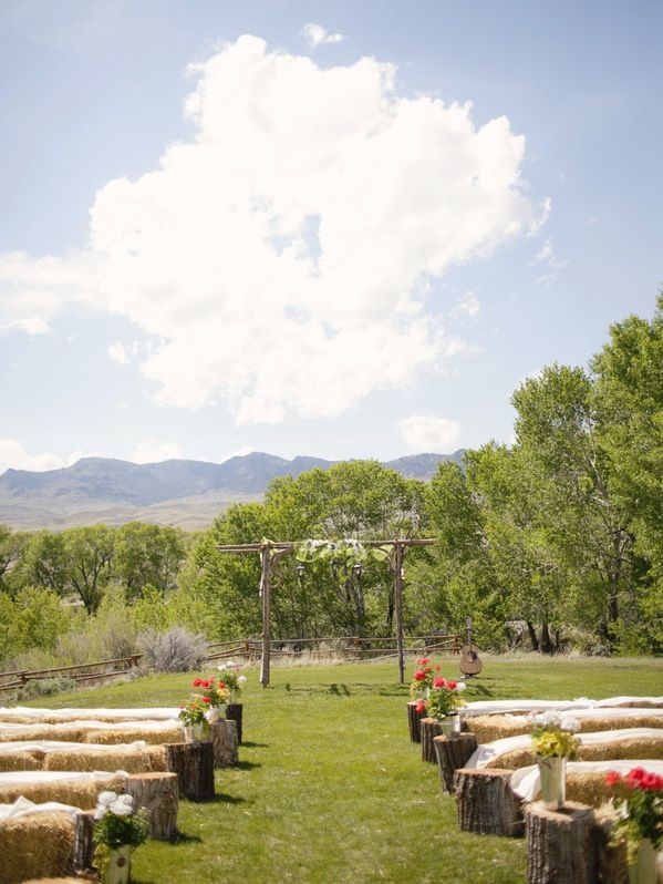 LOVE THIS ALL ..... Hay bale seating & arbour. And I love the tree stumps at the ends of each row