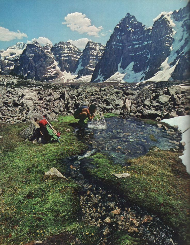 A hiker stops to refresh in the Valley of the Ten Peaks, Canada    National Geographic | June 1980