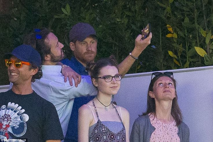 Prince Harry, 32, enjoyed a headline performance by The Killers at the British Summer Time Festival in Hyde Park on Saturday night, where he was snapped drinking beer and taking selfies.