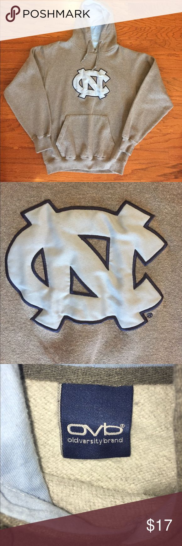 "North Carolina Tarheels Old Varsity Brand Hoodie Good condition, some normal wear, size tag missing and very slight fabric peeling otherwise in very good condition, heather gray with a Carolina blue patch sewn on center of hoodie, 100% cotton material, men's size large, measures about 23"" pit to pit, 27 1/2"" top to bottom and 25"" shoulder to cuff. Old Varsity Brand Shirts Sweatshirts & Hoodies"