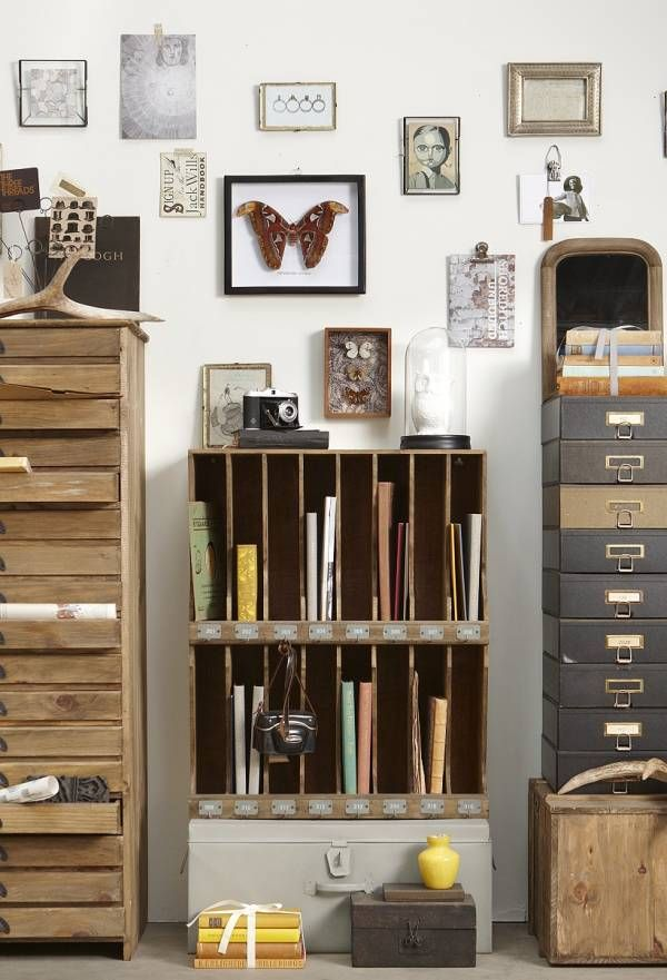 This is my kind of craft space, not all brightly colored  with white laminate furniture! Warm & rustic!!