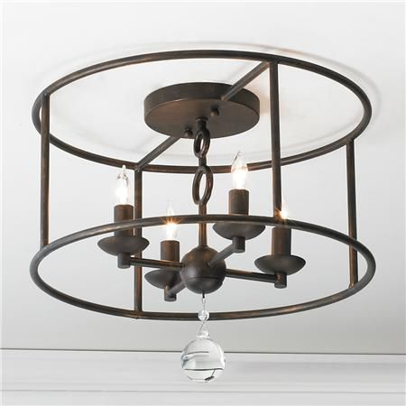 A nice chandelier-esque take on a flush mount light.  Great for low profile areas where you still want something special.