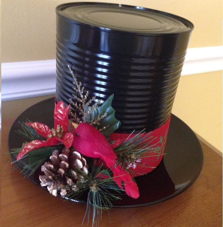 """This fun Frosty the snowman hat was made by Kristy Scanion and she let me share! Here are her instructions…""""I used a black plate from dollar tree, large aluminum can (I work in a school cafeteria so it was easy to get) coffee can would work but might be a little too small. Spray paint, …"""